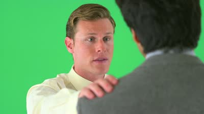 stock-footage-businessman-with-hand-on-colleagues-shoulder-on-greenscreen
