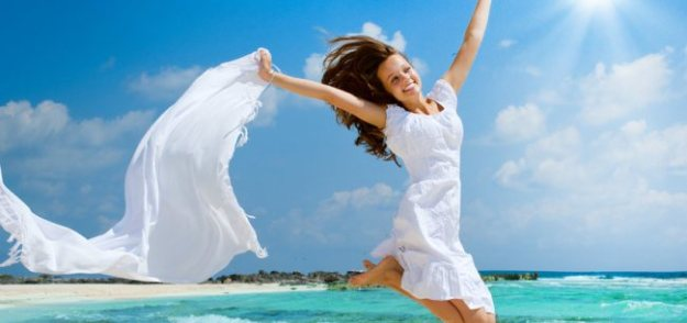 woman-white-beach-jump-850x400-1