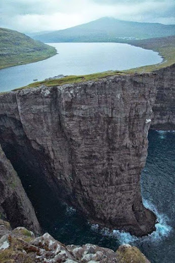 Lake over the ocean in Faroe Islands.
