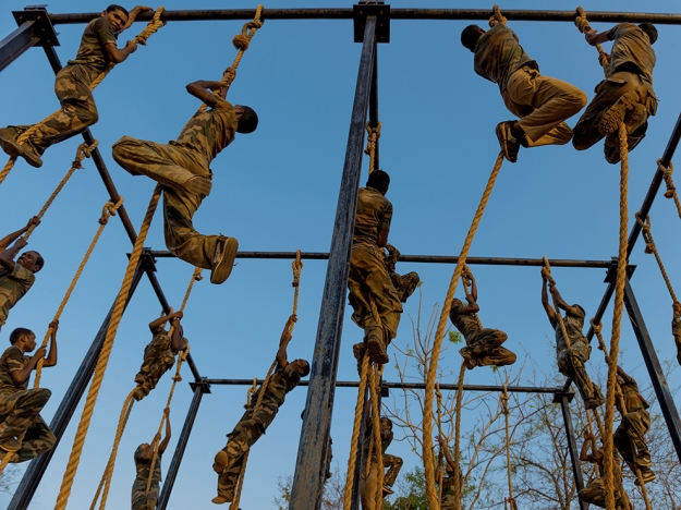 Indian policemen train at the Counter Terrorism and Jungle Warfae College in Kanker, Chhattisgarh, India, May 2, 2012.  The College has trained 23,000 police men in India to be more equipped to handle the Naxal issue, and other terrorism threats facing India today. (Credit: Lynsey Addario) Director of college: Brigadier Ponwar: email:pony3349@yahoo.co.uk; cell:+917868241358